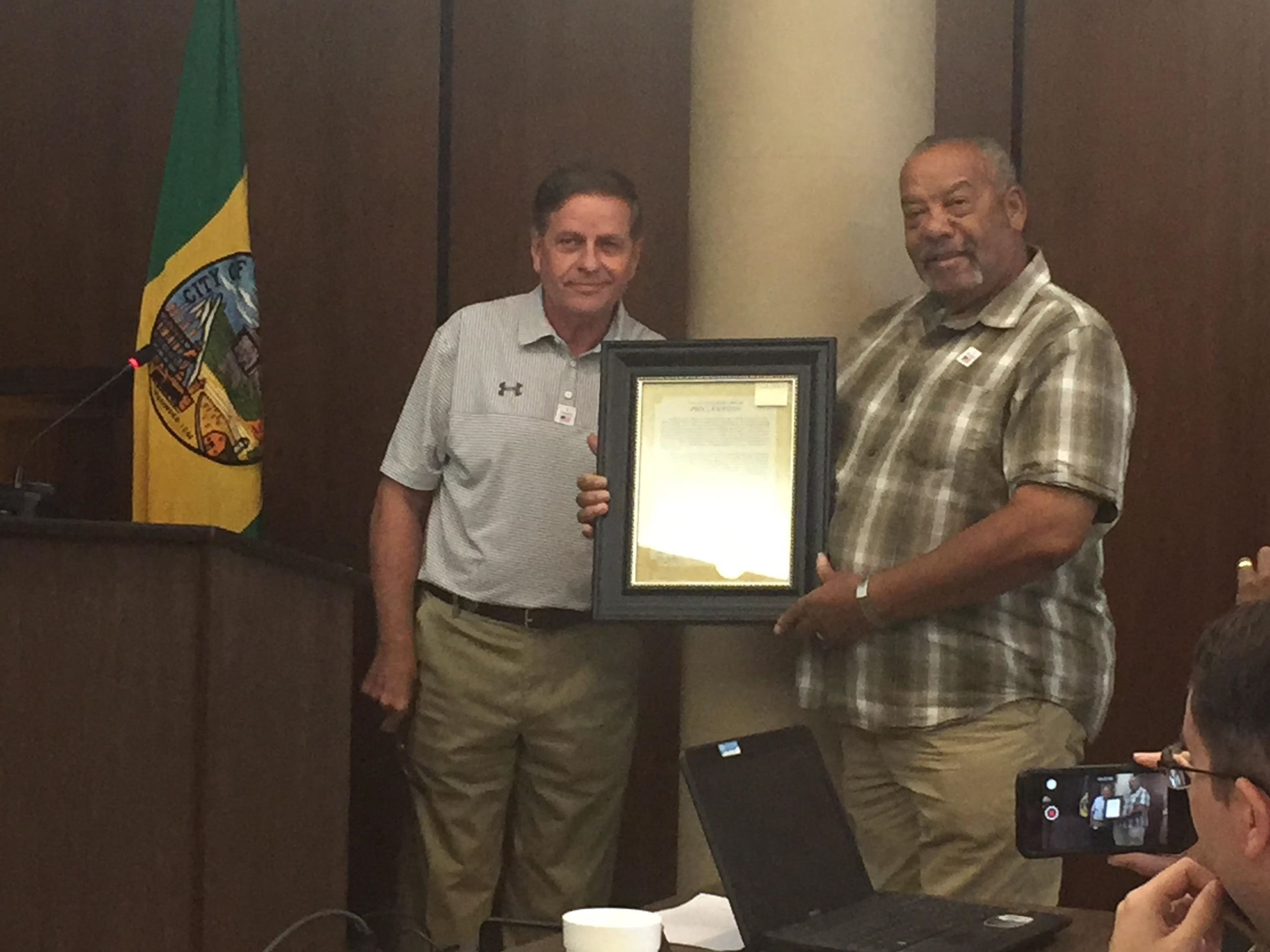 Buster Porch receives his Quality of Life proclamation from Mayor Sherman Guyton.